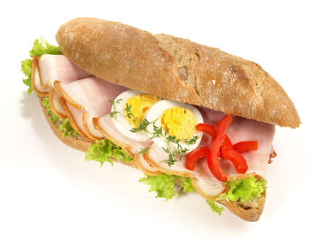 Rye Baguette with Ham and Eggs on white background - Isolated
