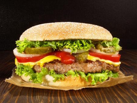 Grilled cheeseburger on wooden background. 版權商用圖片