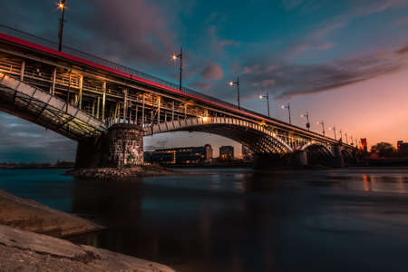 water bus: Long exposure photography of bridge in Warsaw, Poland