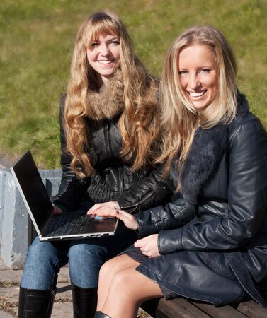 Two cute girls with a laptop photo
