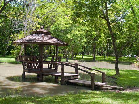 clarifier: Wood pavilion on marsh in children garden, Buddhamonthon, Nakhon Pathom, Thailand