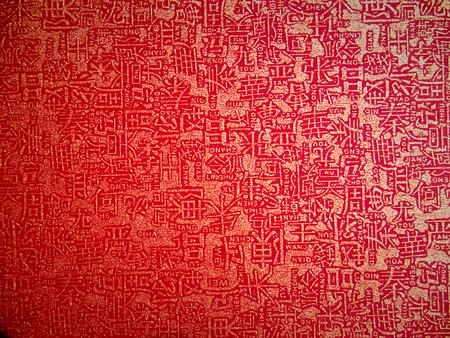 Closeup texture of red paper with chinese letter photo