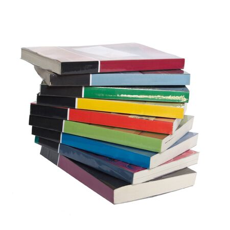 Isolated twisted stack of colorful real books on white background photo