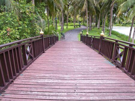 Wooden bridge in Sri Nakorn Kuen Khan Park, Samutprakarn, Thailand photo