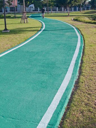 samutprakarn: Green racecourse in public park near museum of  industrial ring road bridge, Samut Prakarn,Thailand