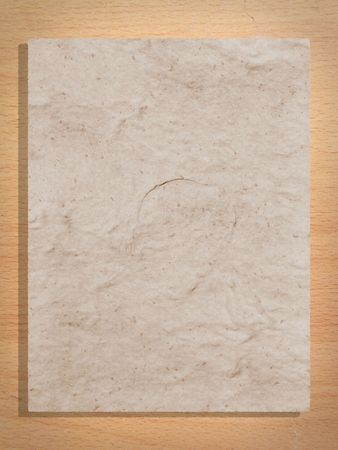 Whole page of mulberry paper on plywood background