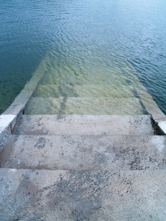 nether: Stairs to the nether world below the lake Stock Photo