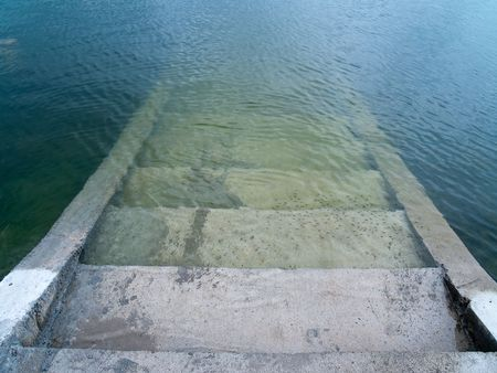 analogy: Stairs to the nether world below the lake Stock Photo