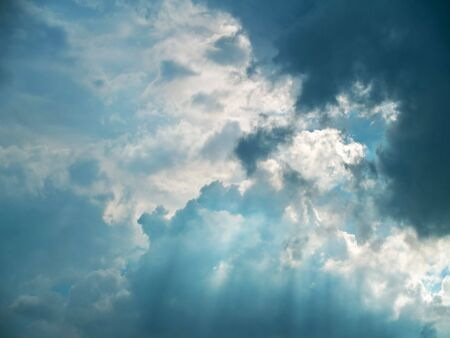 Rays through gloomy clouds befor rain coming Stock Photo