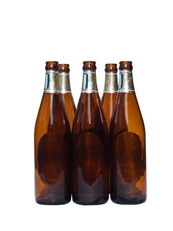 Empty beer bottles isolated over white background photo