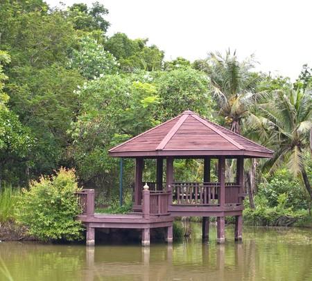 Wooden pavilion in Sri Nakorn Kuen Khan Park, Samutprakarn, Thailand photo