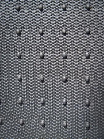 nodal: Black rubber plate background with design detail Stock Photo