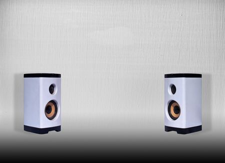 Pair of white loudspeakers isolated on silver metal background photo