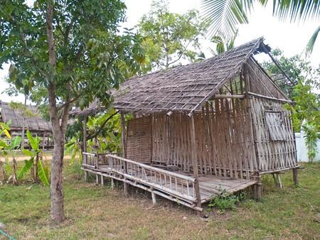 Old dilapidated hut in deserted rural village photo