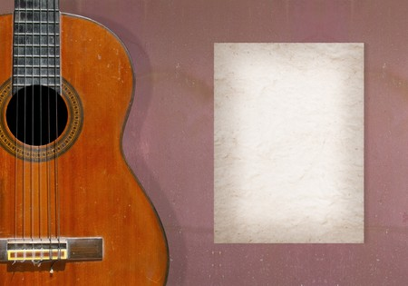vignetting: Classical guitar on grunge wall with blank page of mulberry paper for your note