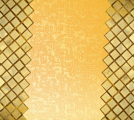 sheeny: Golden mosaic wall  with chinese letters in open area Stock Photo