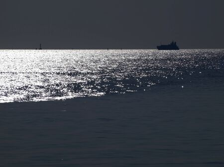 Abstract shining ocean with ocean liner at dusk time Stock Photo - 8569358