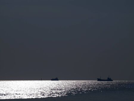 Abstract shining ocean with ocean liner at dusk time Stock Photo - 8628032