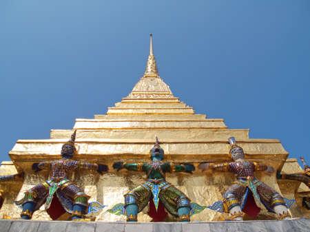 Two gilt chedis in Temple of The Emerald Buddha (Wat Phra Kaew), Bangkok, Thailand photo