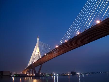 Bhumibol Bridge also casually call as Industrial Ring Road Bridge illuminate with spotlight at night scene, Samut Prakarn, Thailand photo