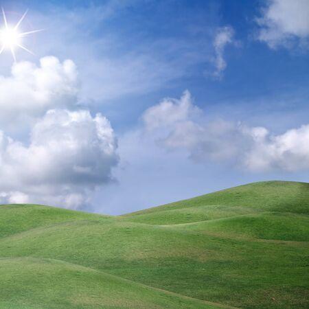 Beautiful cloud over field of green meadow in shining sunlight