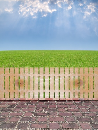 Agriculture garden with wooden fence, stone square paving by granite, paddy field with produce grains and rays from heaven photo