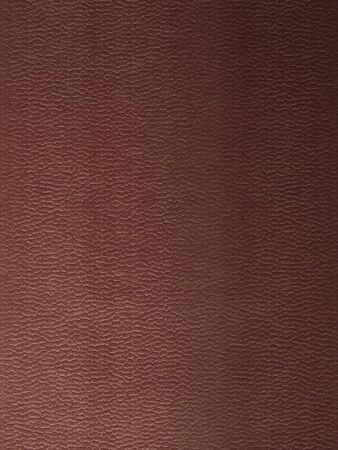 Closeup texture of luxury brown leather with detail photo