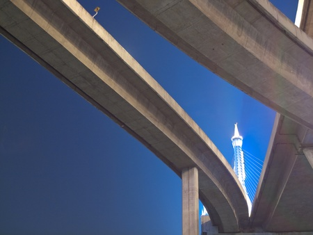 Intersection expressway with grade separation illuminate with spotlight on deep blue sky, Bhumibol Bridge, Samut Prakarn,Thailand Stock Photo - 10097870