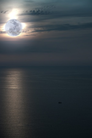 Full moon over water with abstract water and sky Stock Photo - 10097860