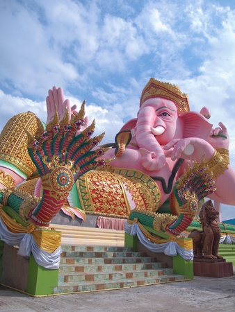 god figure: Ganesha statue with King of Nagas and Leo in Thailand