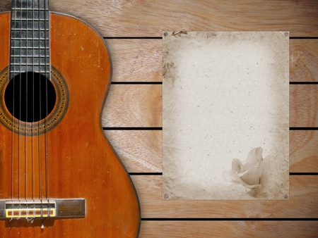 Classical guitar on wood fragment wall with blank page of mulberry paper for some note Stock Photo