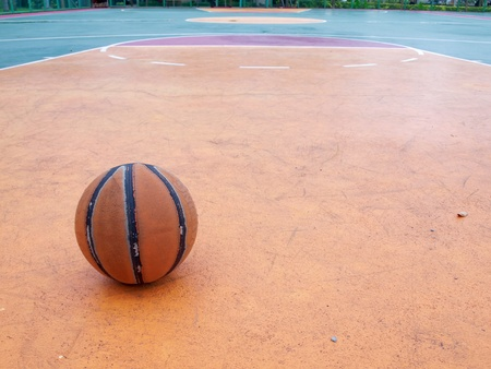 Basketball ball on a outdoor court in public park photo