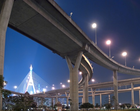 Intersection expressway with grade separation illuminate with spotlight on deep blue sky, Bhumibol Bridge, Samut Prakarn,Thailand