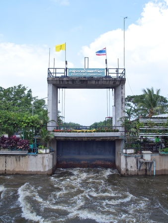 sluice: Thawi Watthana floodgate opening to relieve pressure from flooding, Bangkok, Thailand