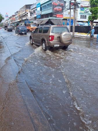 Phetkasem 81, Bangkok, Thailand - November 3 : Heavy flooding from monsoon rain in center of Thailand arriving in Bangkok suburbs on November 3, 2011 in Soi Phetkasem 81, Bangkok, Thailand. Stock Photo - 11079088