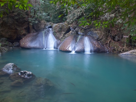 Emerald color water in tier fourth of Erawan waterfall, Erawan National Park, Kanchanaburi, Thailand photo