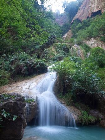 beck: Emerald color water in tier seventh of Erawan waterfall, Erawan National Park, Kanchanaburi, Thailand Stock Photo