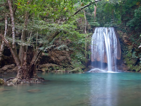 tier: Emerald color water in tier third of Erawan waterfall, Erawan National Park, Kanchanaburi, Thailand Stock Photo