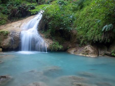 tier: Emerald color water in tier seventh of Erawan waterfall, Erawan National Park, Kanchanaburi, Thailand Stock Photo