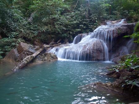 tier: Emerald color water in tier first of Erawan waterfall, Erawan National Park, Kanchanaburi, Thailand Stock Photo