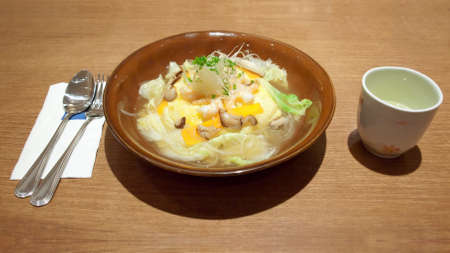 Omelette rice omurice or oromuraisu  in japanese soup with shiitake mushroom, shrimp and vegetable, japanese food photo