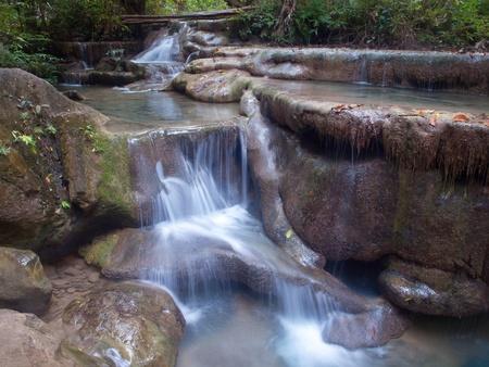 Emerald color water in tier fifth of Erawan waterfall, Erawan National Park, Kanchanaburi, Thailand Stock Photo - 12780900