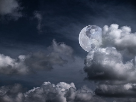 Moon with a sign of Yin Yang in the clouds