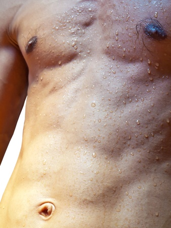 shower man: Wet torso with water drops against the white background