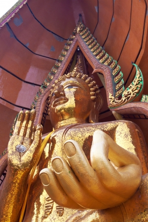 Big golden buddha statue in vitarka mudra posture, Wat Tham Sua(Tiger Cave Temple), Tha Moung, Kanchanburi, Thailand photo