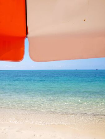 Sunshade on beach in island in sunny summer day photo