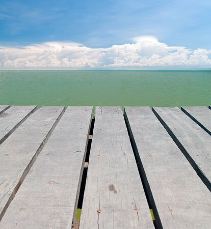 Seaside wooden bridge with beautiful cloudy and emerald color backwater sea photo