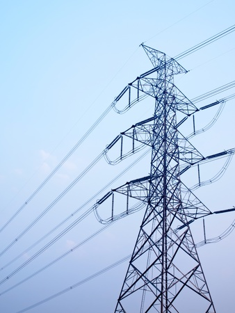 High voltage post against clear blue sky Stock Photo - 18548665
