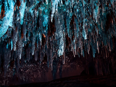Stalactite wall illuminated with color light in Tham Khao Bin cave, Ratchaburi, Thailand photo