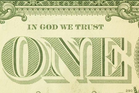 Macro detail of in god we trust on one dollar bill photo